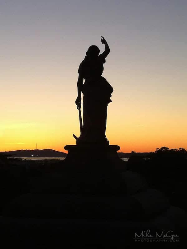 Stone statue taken at sunset in the cemetery hills of Oakland, California