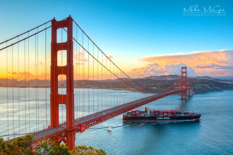 Cargo Ship Heading Out to the Pacific Ocean under Golden Gate Bridge