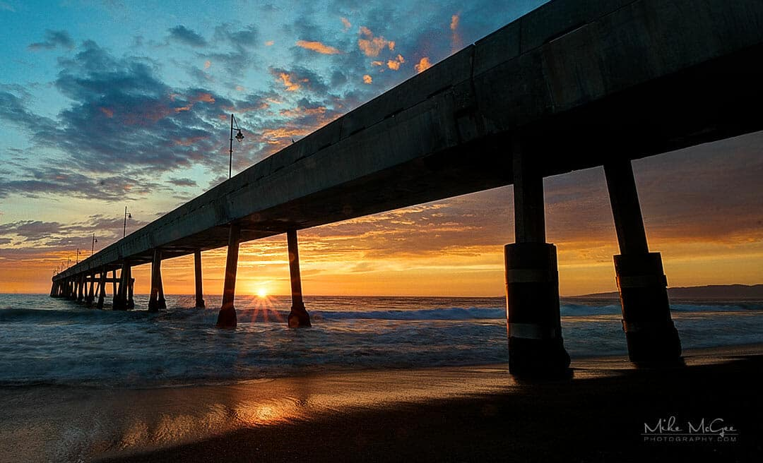 Sunset under the pier in Pacifica, California